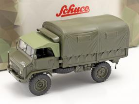 Mercedes-Benz Unimog 404 S Pickup truck with cover Military vehicle olive 1:35 Schuco