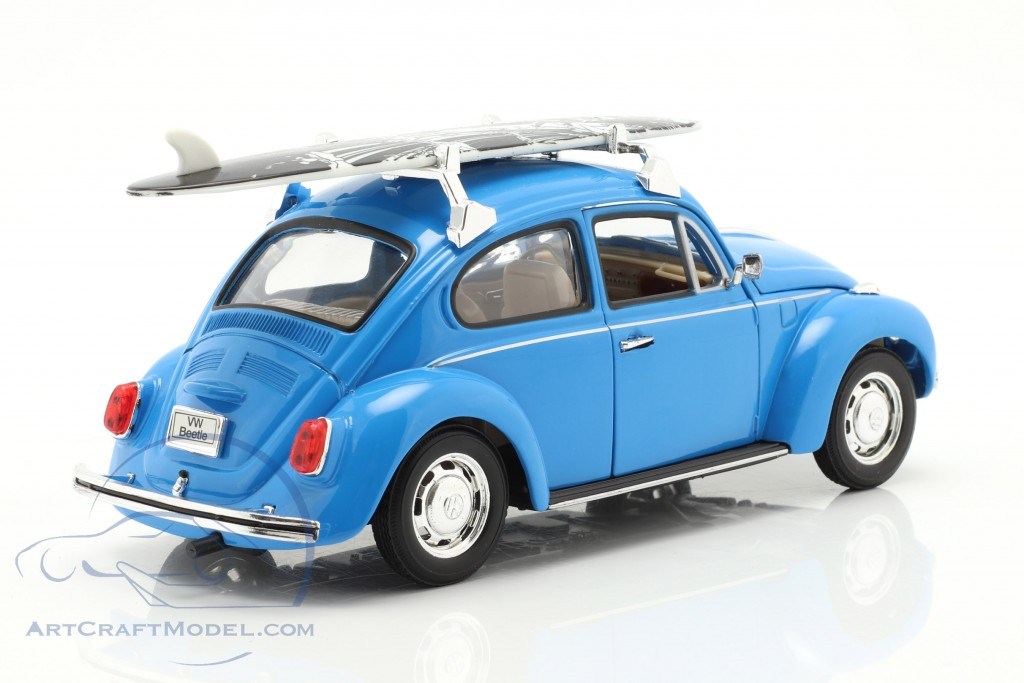 Volkswagen VW Beetle with black and white surfboard year 1959 blue