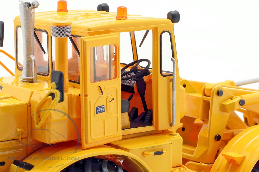 Kirovets K-700 M with front loader yellow